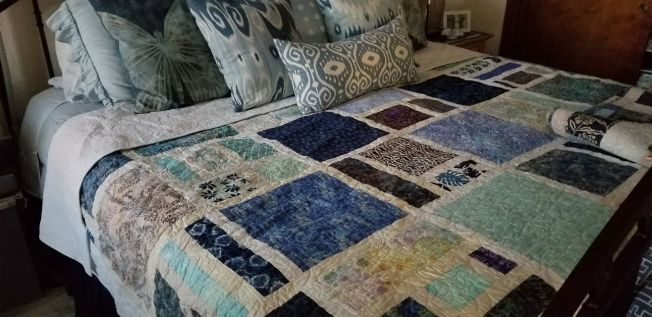 Snow White Quilt on a bed
