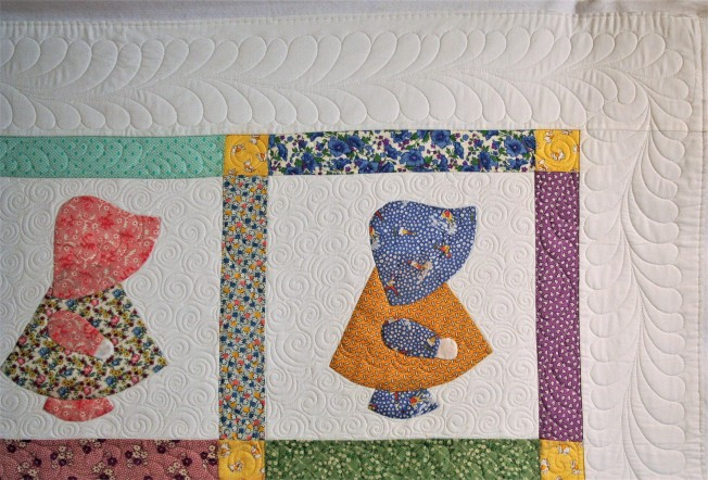 Sunbonnet Sue and Feathers (close up border)